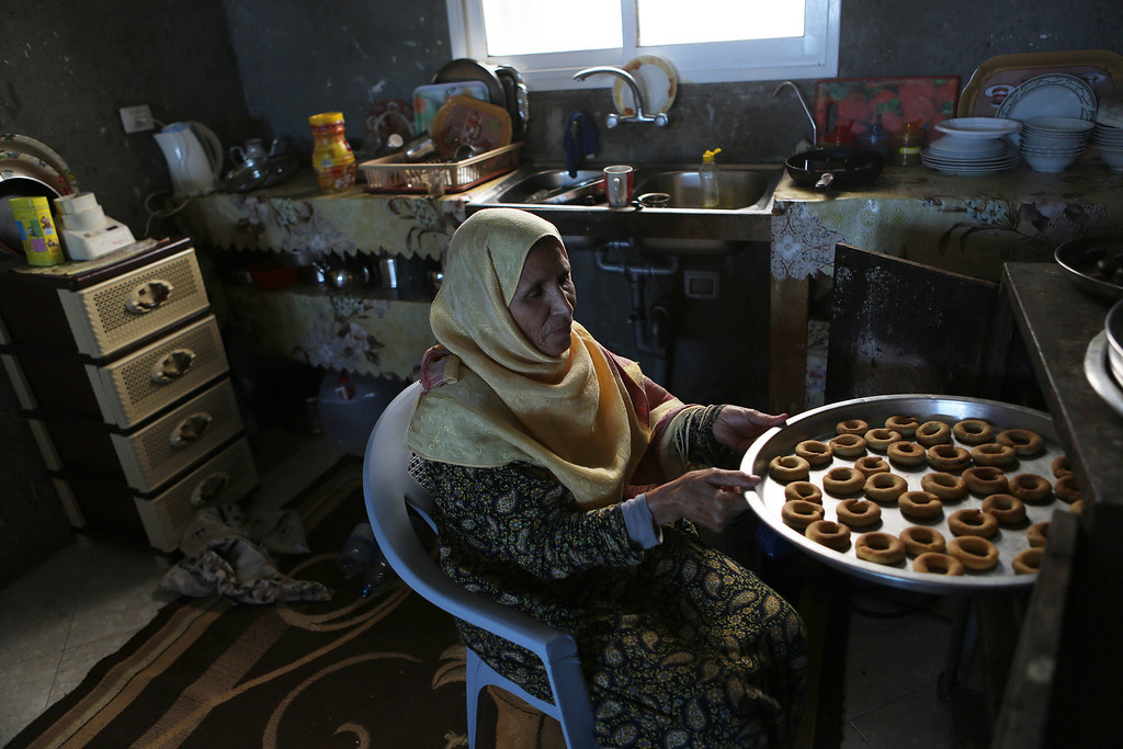 . A Palestinian woman makes traditional date-filled cookies in preparation for the Eid al-Adha celebrations on October 2, 2014, in Khan Yunis\' Khuzaa neighbourhood in the southern Gaza Strip. Muslims across the world are preparing to celebrate the annual festival of Eid al-Adha, or the Festival of Sacrifice, which marks the end of the Hajj pilgrimage to Mecca and commemorates Prophet Abraham\'s readiness to sacrifice his son to show obedience to God. SAID KHATIB/AFP/Getty Images