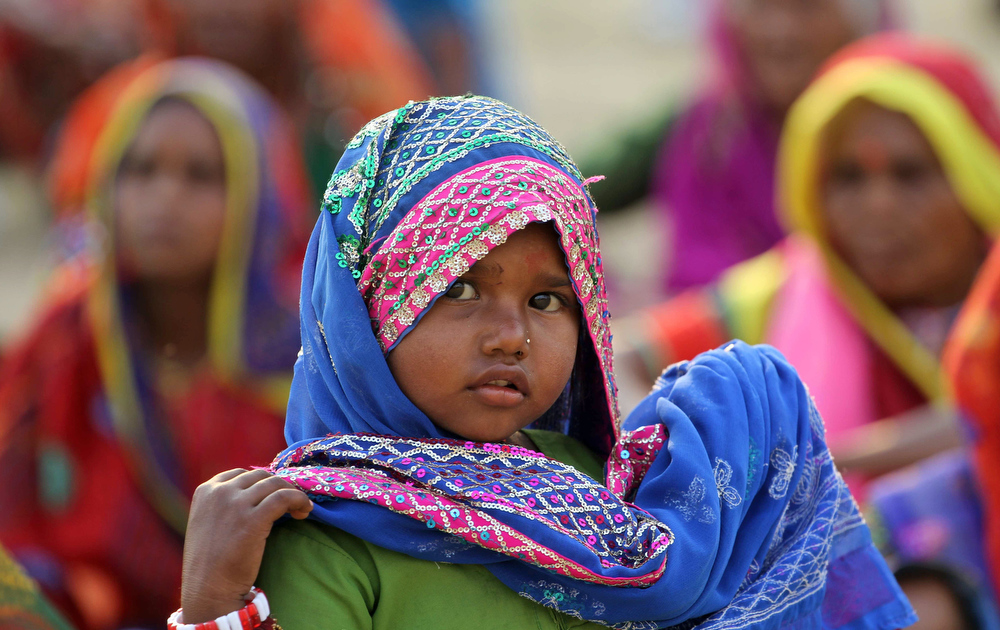 Description of . An Indian child attends an event to support the