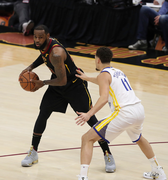 . Cleveland Cavaliers\' LeBron James is defended by Golden State Warriors\' Klay Thompson in the first half of Game 3 of basketball\'s NBA Finals, Wednesday, June 6, 2018, in Cleveland. (AP Photo/Carlos Osorio)