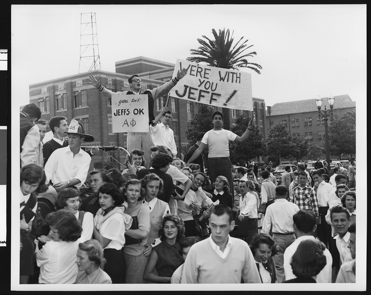 Students with signs supporting University of Southern California football coach Jeff Cravath, USC campus, 1950.