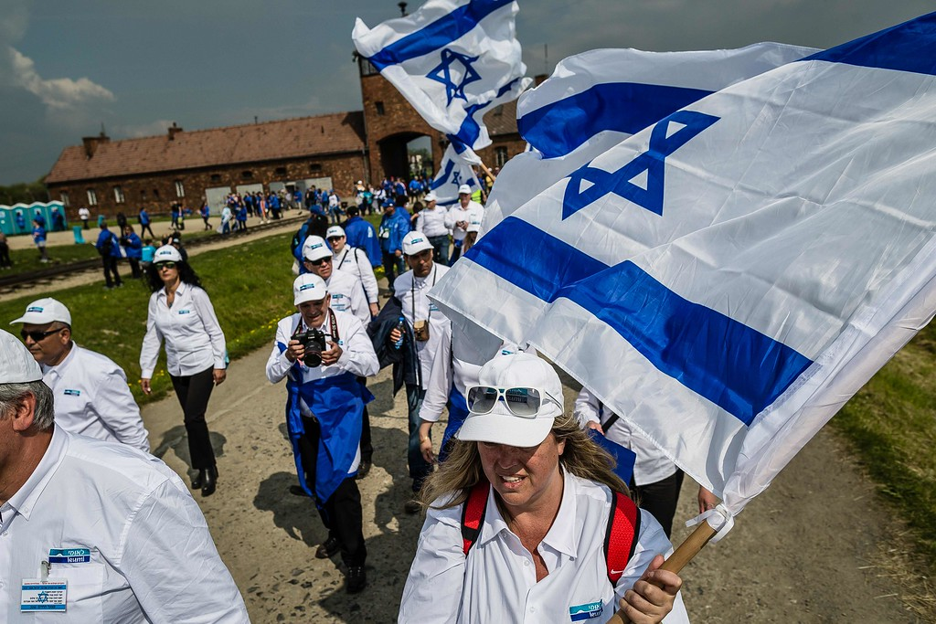 """. Participants of the annual \""""March of the Living\"""" walk over the grounds of the former Auschwitz-Birkenau Nazi death camp in Brzezinka (Birkenau) near Oswiecim (Auschwitz), Poland, on May 5, 2016. Thousands of young Jews from 40 nations marched alongside a handful of Holocaust survivors and Polish teenagers in homage to the victims of the former Auschwitz-Birkenau WWII death camp in southern Poland. / AFP PHOTO / WOJTEK  RADWANSKI/AFP/Getty Images"""