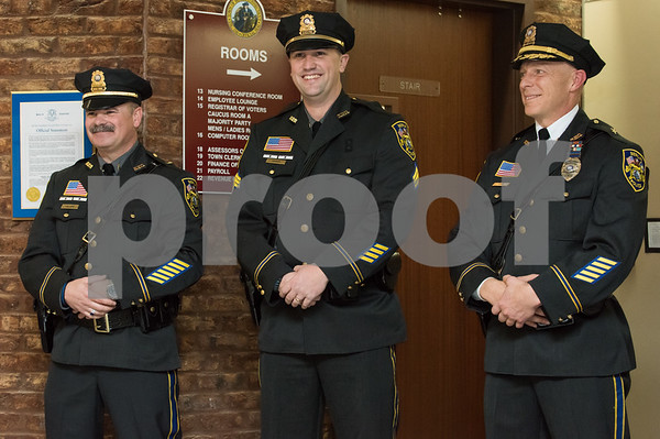 01/17/18 Wesley Bunnell | Staff The Berlin Police Department held a promotion ceremony for two officers on Wednesday evening at town hall. Lieutenant Drew Gallupe and Sergeant Ryan Gould as they stand with Deputy Chief Christopher Ciuci.