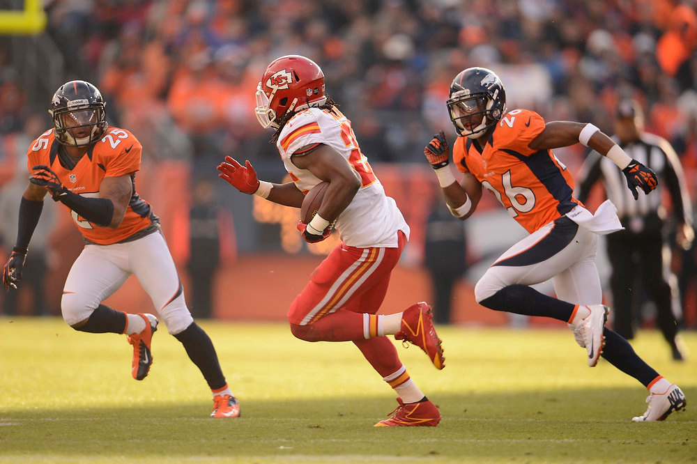 . Kansas City Chiefs running back Jamaal Charles (25) makes a run in the first quarter as Denver Broncos free safety Rahim Moore (26) and Denver Broncos cornerback Chris Harris (25) pursue as the Denver Broncos took on the Kansas City Chiefs at Sports Authority Field at Mile High in Denver, Colorado on December 30, 2012. John Leyba, The Denver Post