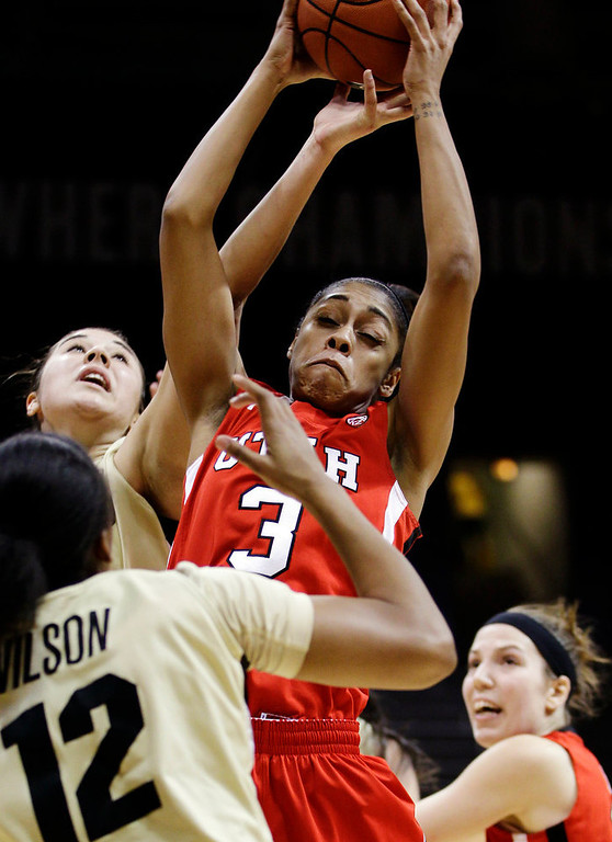 . Utah\'s Iwalani Rodrigues (3) grabs for a rebound against Colorado\'s Ashley Wilson (12) during the second half of their NCAA college basketball game, Tuesday, Jan. 8, 2013, in Boulder, Colo. Colorado won 67-57. (AP Photo/Brennan Linsley)