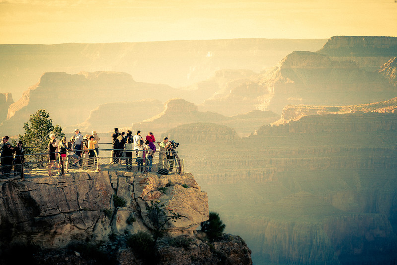 People of Mather Point - Grand Canyon This is one of the points in the Grand Canyon called Mather Point. It's one of the more popular spots. I found having people in the shot really helps illustrate the scale of the Grand Canyon.  See this photo at AlikGriffin.com