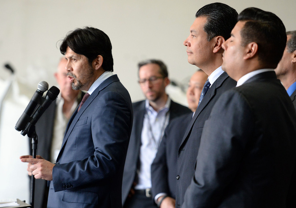. Senator Kevin de Leon, left, D-Los Angeles speaks as Sen. Alex Padilla, center, D-Pacoima and Senator Ricardo Lara, right, D-Huntington Park/ Long Beach listen as they announce the support for legislation to ban single use plastic bags during a press conference at Command Packaging in Vernon, Calif., on Friday, Jan. 24, 2014. (Keith Birmingham Pasadena Star-News)