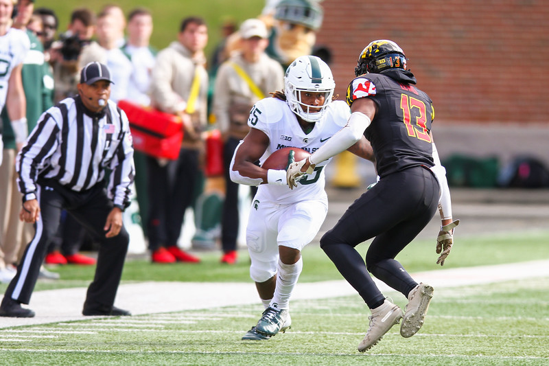 Michigan State WR #25 Darrell Stewart Jr. attempts to evade a tackle by Maryland DB #13 Rayshad Lewis