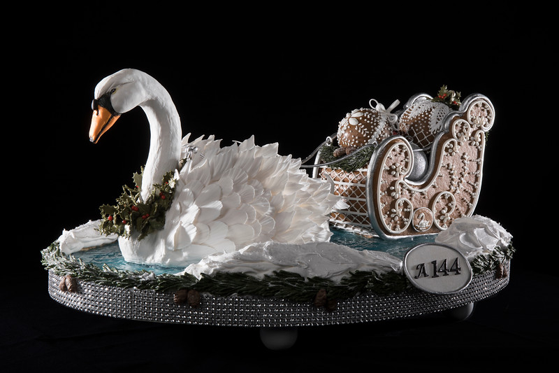 swan figure with christmas carriage