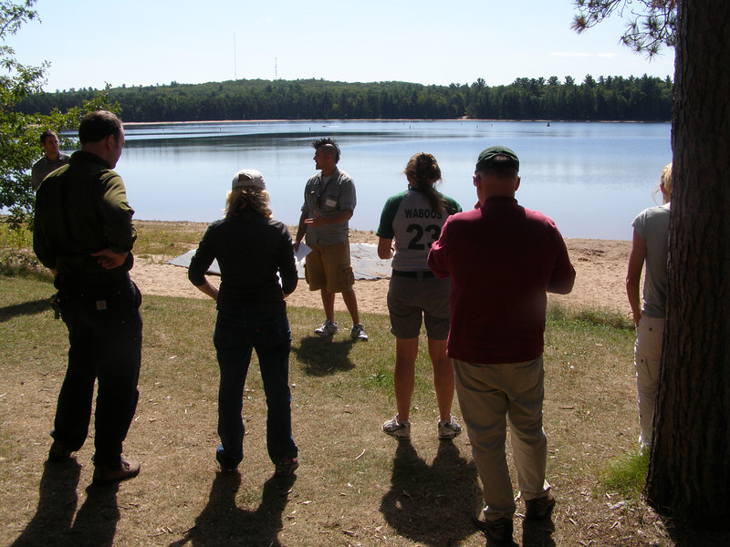 After their visit to North Creek, site reviewers gathered on the shores of Crystal Lake to hear about an ambitious whole-lake mixing project.