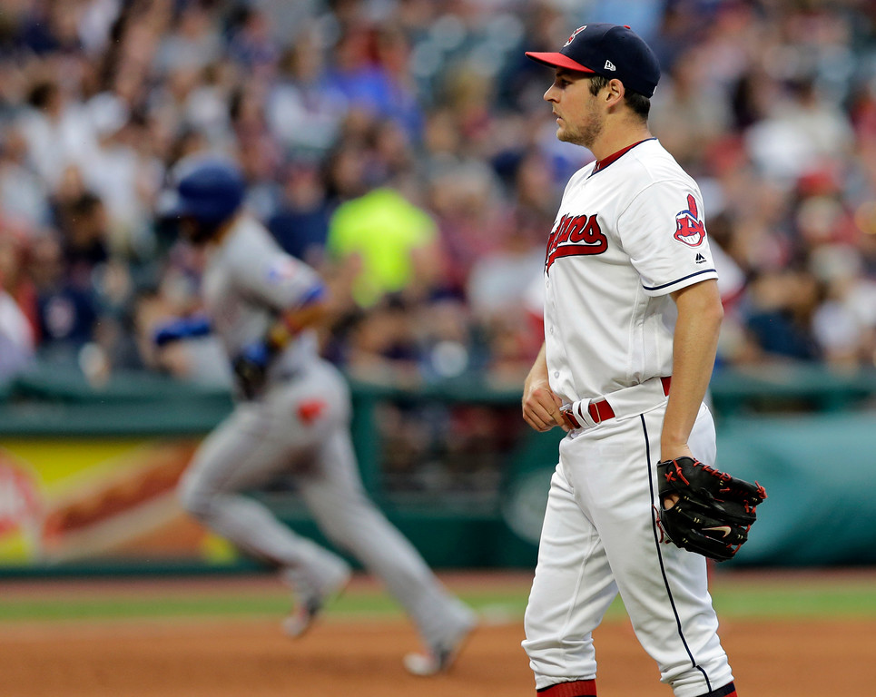 . Cleveland Indians starting pitcher Trevor Bauer waits for Texas Rangers\' Robinson Chirinos to run the bases after Chirinos hit a solo home run in the fifth inning of a baseball game, Wednesday, June 28, 2017, in Cleveland. (AP Photo/Tony Dejak)