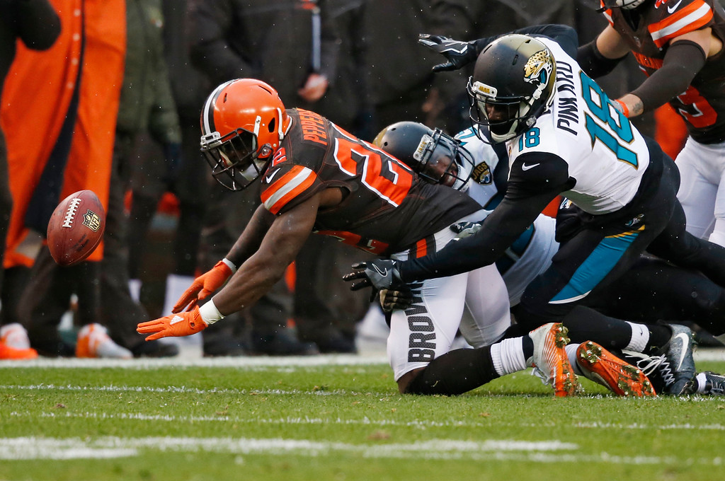 . Cleveland Browns safety Jabrill Peppers (22) fumbles a punt in the second half of an NFL football game against the Jacksonville Jaguars, Sunday, Nov. 19, 2017, in Cleveland. (AP Photo/Ron Schwane)