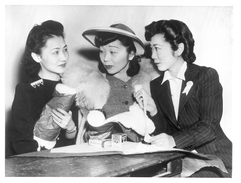 """""""Loyal Americans All.  These Japanese-American girls, born and reared in this country, are doing what they can for this country's victory"""" -- caption on photograph"""