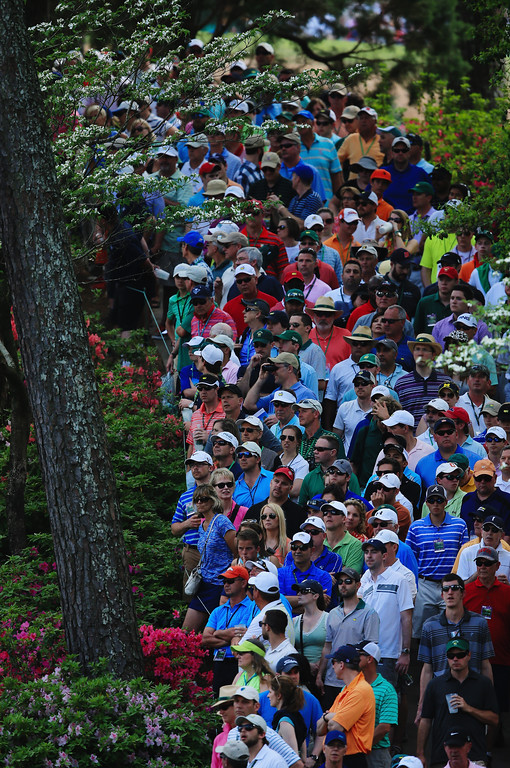 . Patrons watch the play on the sixth hole during the final round of the 2014 Masters Tournament at Augusta National Golf Club on April 13, 2014 in Augusta, Georgia.  (Photo by David Cannon/Getty Images)