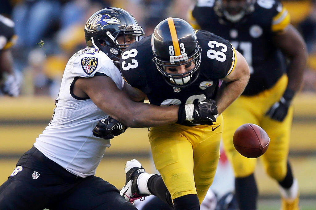 . Baltimore Ravens linebacker Daryl Smith, left, knocks the ball from Pittsburgh Steelers tight end Heath Miller (83) for a fumble in the second quarter of an NFL football game in Pittsburgh on Sunday, Oct 20, 2013. The Ravens recovered the ball. (AP Photo/Gene J. Puskar)