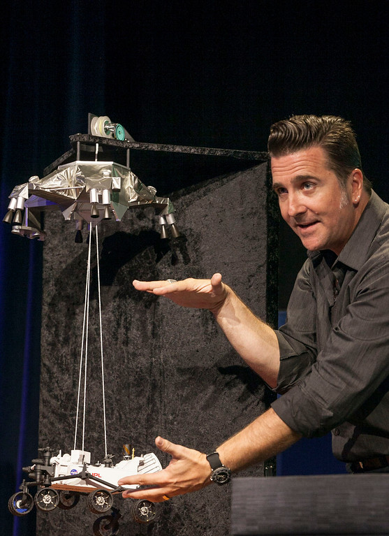 . FILE - In this Thursday, Aug. 2, 2012 file photo, Adam Steltzner, Mars Science Laboratory\'s entry, descent and landing phase leader at JPL uses a scale model to explain the process during the Mission Engineering Overview news briefing at NASA\'s Jet Propulsion Laboratory in Pasadena, Calif. (AP Photo/Damian Dovarganes, File)