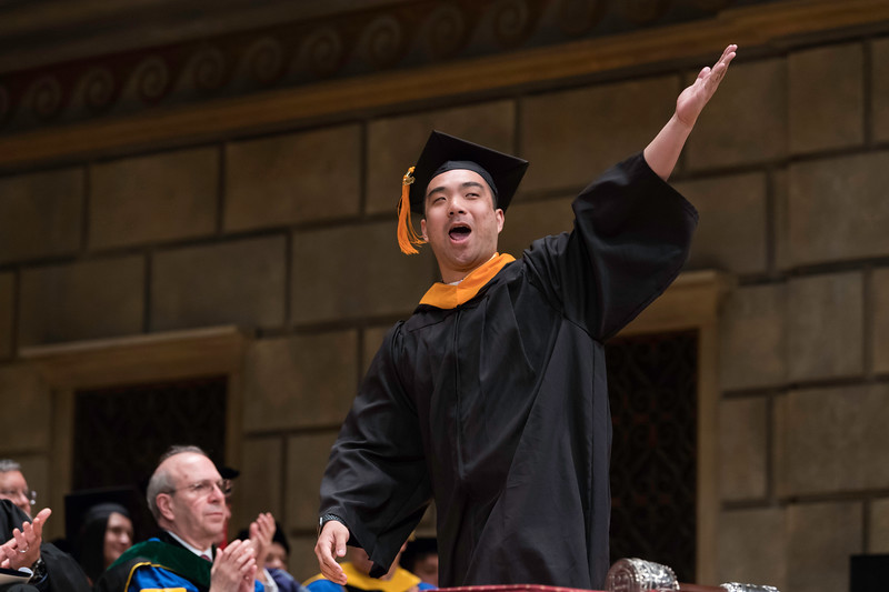 Cory Chan celebrates as he crosses the stage after receiving his bachelor of science degree. // University of Rochester School of Nursing Commencement, Kodak Hall at Eastman Theatre May 17, 2019.  // photo by J. Adam Fenster / University of Rochester