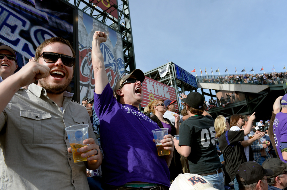 . DENVER, CO. - APRIL 04: Carter Mann and Brandon Hamilton cheer after a Carlos Gonzalez home run during the sixth inning of the Colorado Rockies home opener against the Arizona Diamondbacks at Coors Field in Denver, CO April 04, 2014. (Photo By Craig F. Walker / The Denver Post)