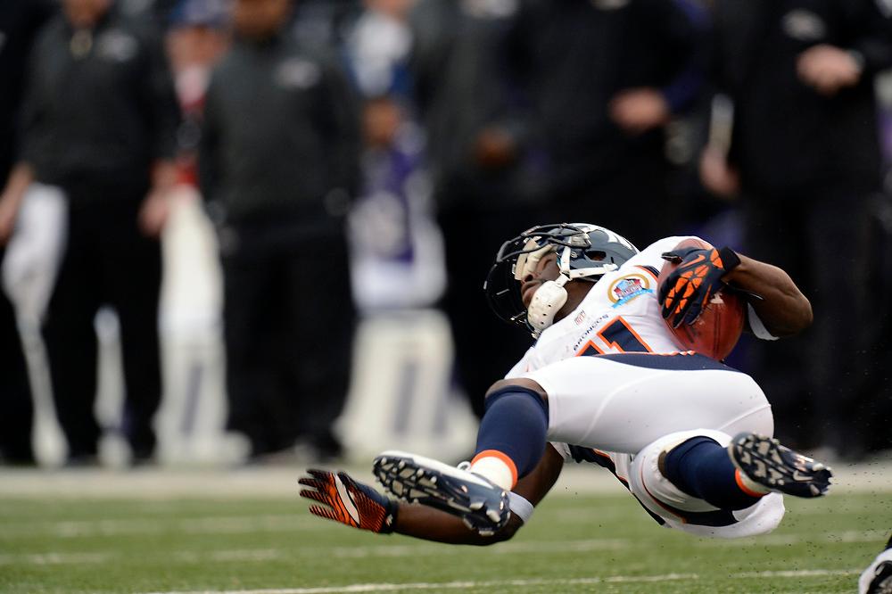 . Denver Broncos wide receiver Trindon Holliday #11 up ended at the M&T Bank Stadium, in Baltimore, MD Sunday December 16, 2012.      Joe Amon, The Denver Post