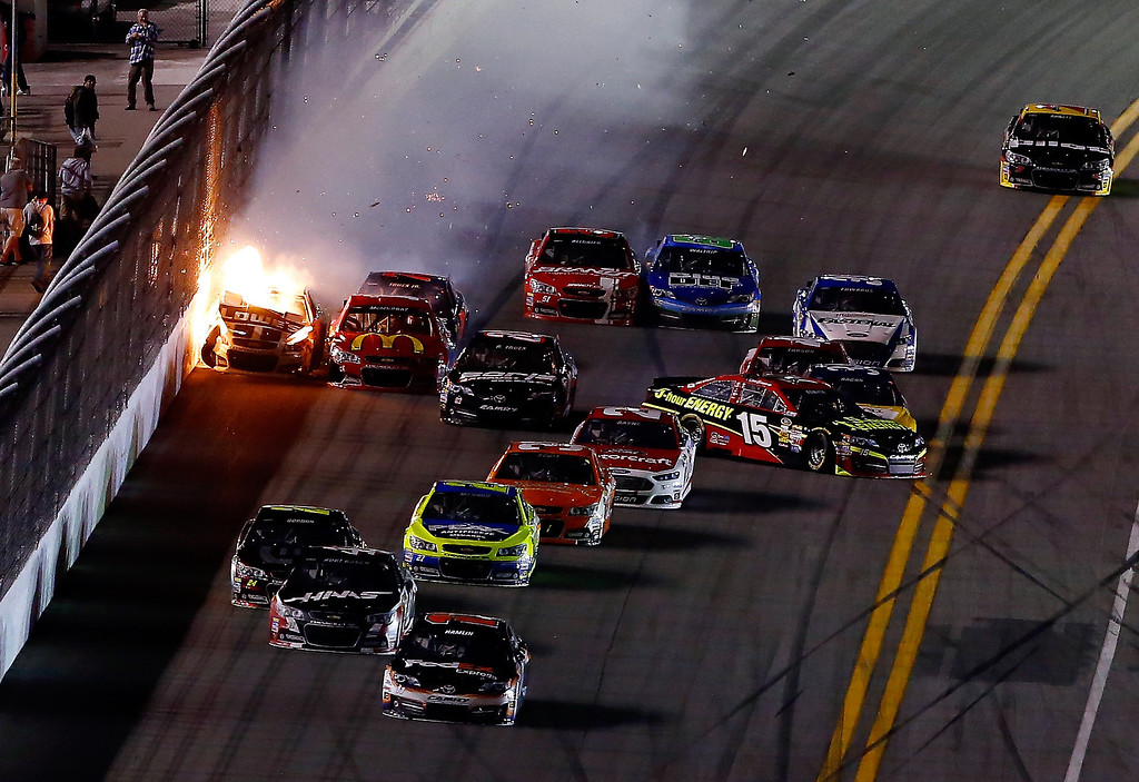 . Jamie McMurray, driver of the #1 McDonald\'s Chevrolet, Jimmie Johnson, driver of the #48 Lowe\'s Chevrolet, Kyle Larson, driver of the #42 Target Chevrolet, and Clint Bowyer, driver of the #15 5-hour ENERGY Toyota, are involved in an incident on the last lap of the NASCAR Sprint Cup Series Budweiser Duel 2 at Daytona International Speedway on February 20, 2014 in Daytona Beach, Florida.  (Photo by Brian Lawdermilk/Getty Images)