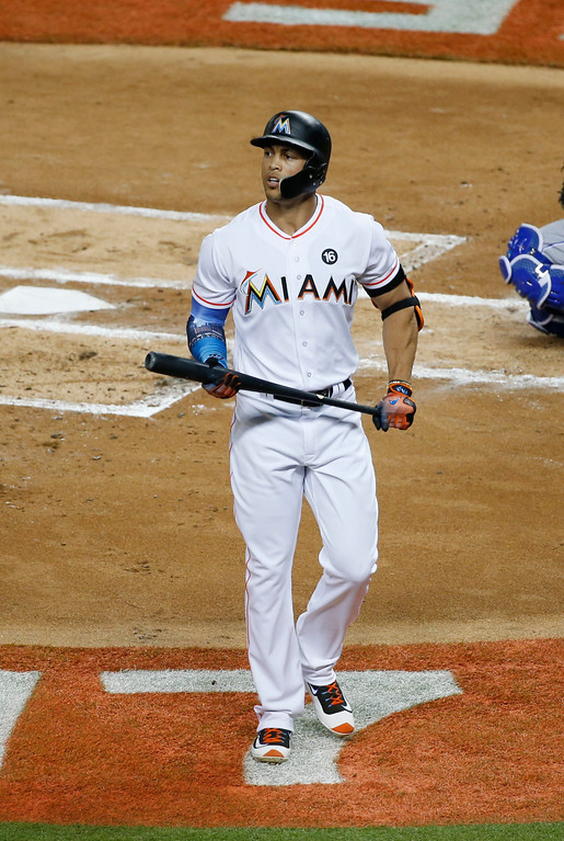 . National League\'s Miami Marlins Giancarlo Stanton (27), walks off the field after striking out in the first inning, during the MLB baseball All-Star Game, Tuesday, July 11, 2017, in Miami. (AP Photo/Wilfredo Lee)