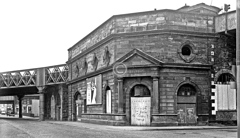 Cumberland St and Salisbury St.    The railway stations, lines and companies serving the Gorbals are the source of much confusion. This, though in Cumberland St, was not Cumberland St Station (which was in Eglinton St). According to SCRAN this was Main St Station, though some way from Gorbals Main St (where there was another station). It seems to have opened in 1872 (or 1877) and closed in 1900, but after 109 years of disuse this structure still stands. The track-level buildings are said to have been removed in 1969, but there is clearly still some sort of superstructure here.    April 1973