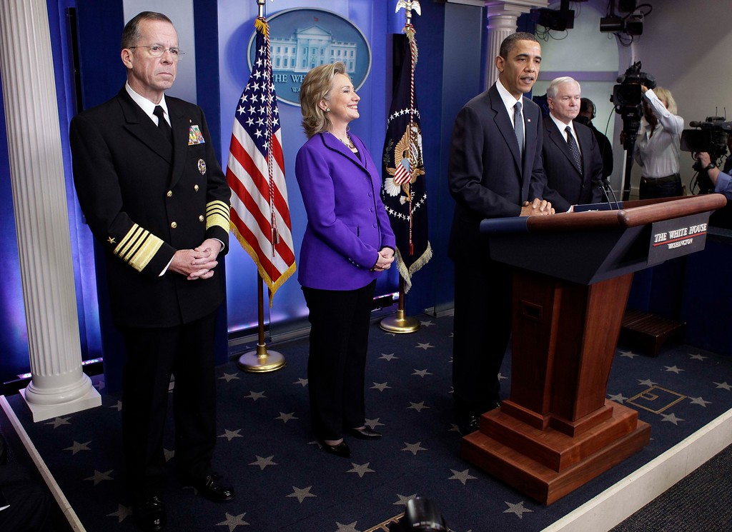 . President Barack Obama, accompanied by, from left, Joint Chiefs Chairman Adm. Michael Mullen, Secretary of State Hillary Rodham Clinton, and Defense Secretary Robert Gates, makes a statement on the new nuclear arms reduction treaty between the U.S. and Russia Secretary, Friday, March 26, 2010, in the press briefing room of the White House in Washington. (AP Photo/J. David Ake)