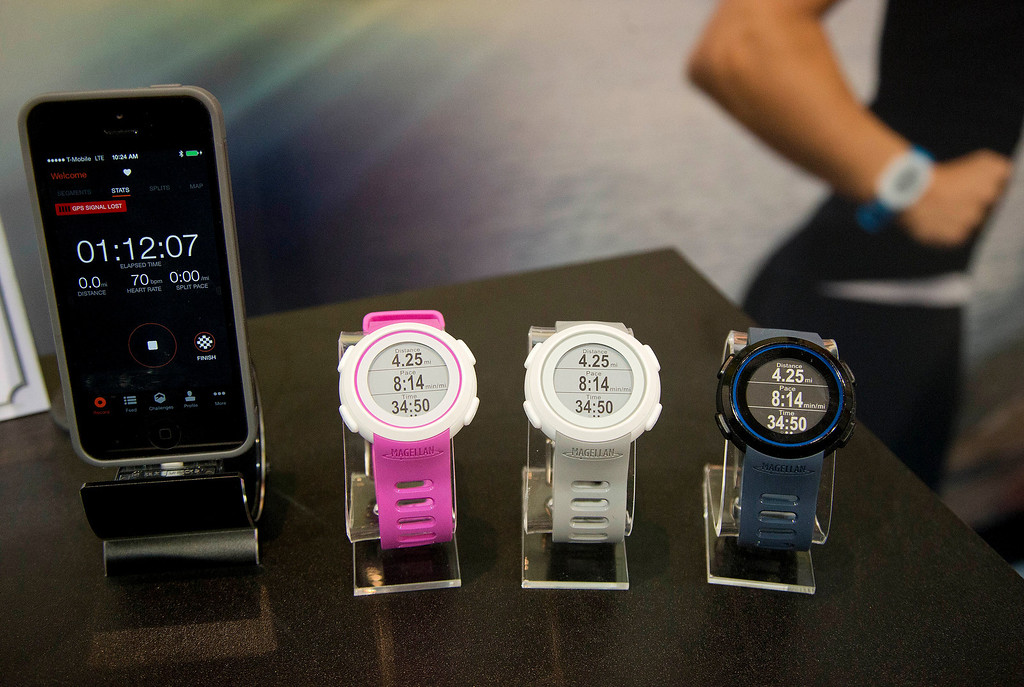 . Magellan Echo smart sports watches sit on display at the International Consumer Electronics Show, Wednesday, Jan. 8, 2014, in Las Vegas. The watch can sync with mobile devices to make the most out of the user\'s sports apps. (AP Photo/Julie Jacobson)