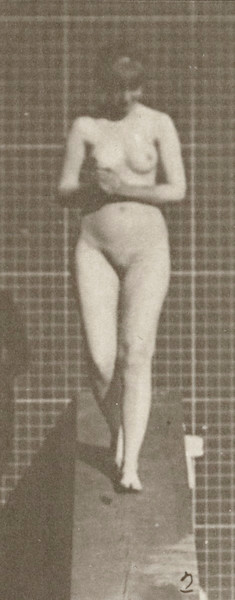 Nude woman descending an incline with hands clasped in front