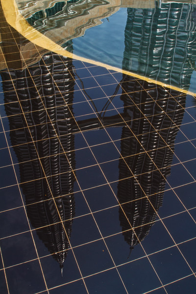 Gorgeous reflection of the Petronas Towers on water there!
