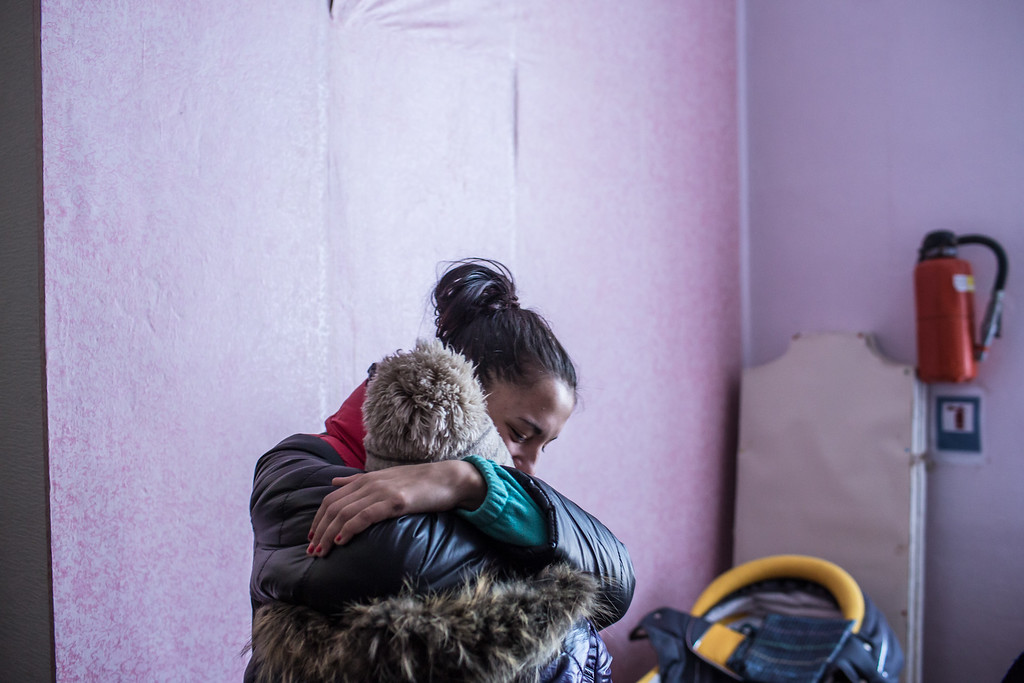 . MYRONIVSKYI, UKRAINE - FEBRUARY 17: Two girls share a hug at a distribution point for humanitarian aid at the local House of Culture on February 17, 2015 in Myronivskyi, Ukraine. A ceasefire agreed to by Ukraine and pro-Russian rebel forces has failed to prevent fighting in the nearby town of Debaltseve, where thousands of Ukrainian troops remain and whom rebels claim to have surrounded. (Photo by Brendan Hoffman/Getty Images)