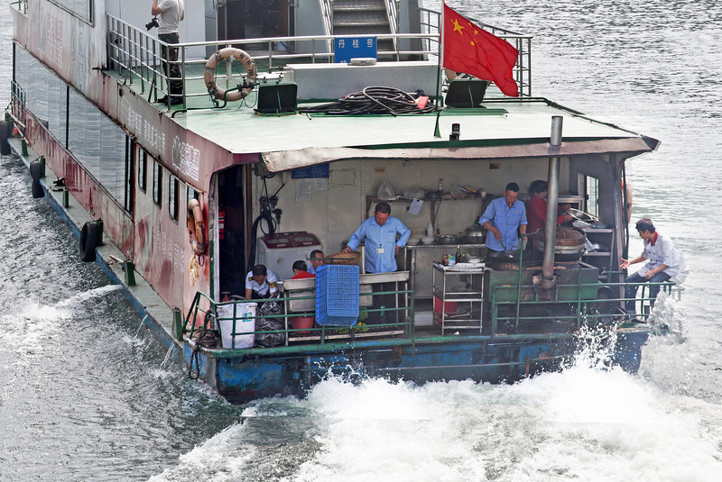 Cooks on the back of a Chinese sightseeing boat on Li River