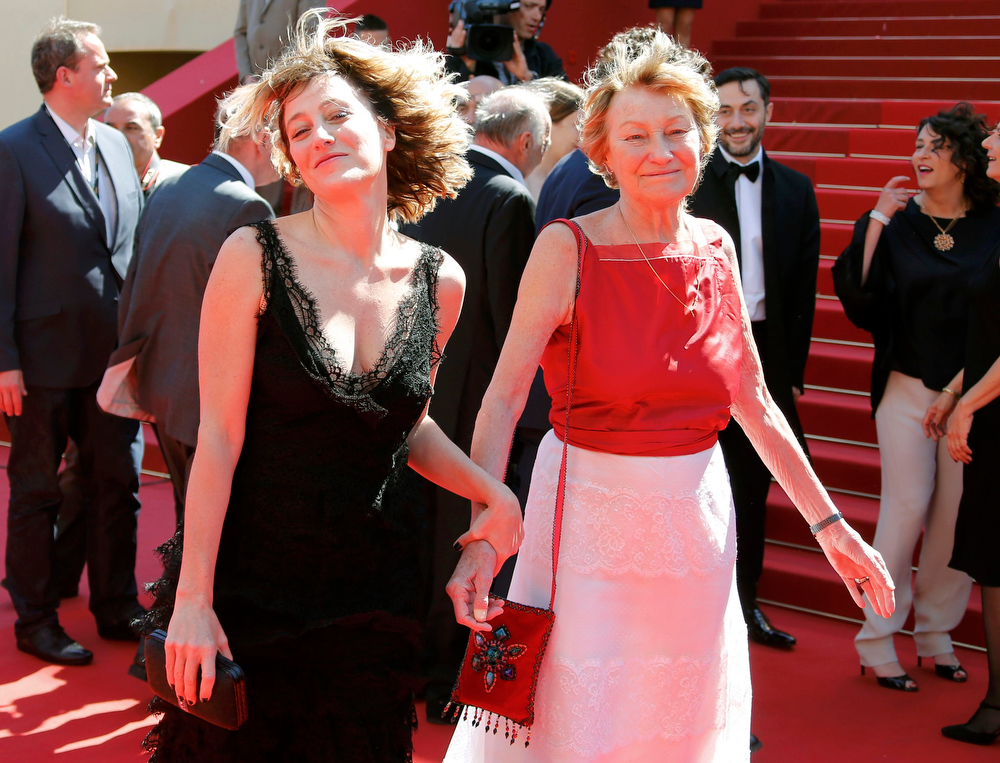 ". Director Valeria Bruni Tedeschi (L) and her mother and cast member Marisa Bruni Tedeschi pose on the red carpet as they arrive for the screening of the film ""Un Chateau en Italie\"" in competition during the 66th Cannes Film Festival in Cannes May 20, 2013.                  REUTERS/Yves Herman"