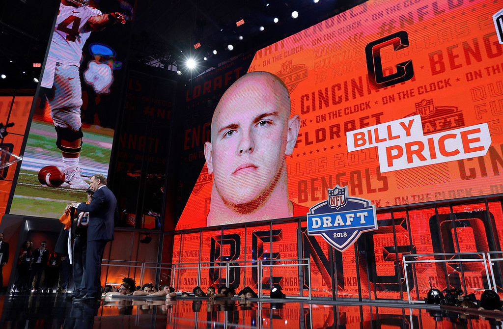 . Commissioner Roger Goodell, left, poses with a fan after the Cincinnati Bengals selected Billy Price during the first round of the NFL football draft, Thursday, April 26, 2018, in Arlington, Texas. (AP Photo/David J. Phillip)