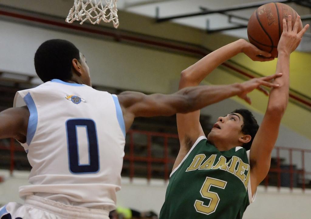 . Damien\'s Andy Torices (5) shoots past Walnut\'s Zuri Williams (0) in the first half of the Glendora basketball tournament at Glendora High School in Glendora, Calif., on Friday, Dec. 13, 2013. Damien won 66-60.  (Keith Birmingham Pasadena Star-News)