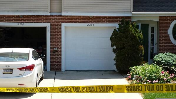 Description of . The house on the left is where a woman was shot Monday morning in Montgomery Township, Pa. The house on the right appears to have blood on the doorbell. (Photo by Dan Sokil)
