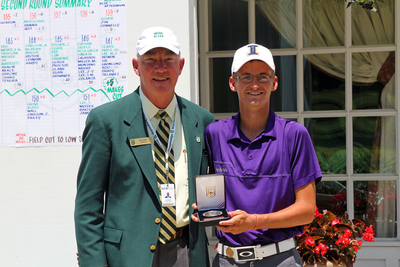 WGA Chairman Jim Bunch poses with runner-up Dylan Meyer following play of the 96th Western Junior at Meridian Hills Country Club.
