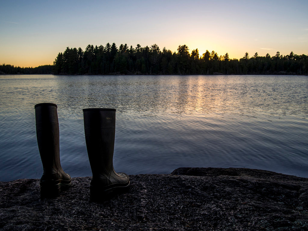 . Rubber boots used to portage into the Boundary Waters Canoe Area Wilderness dry along the shore of Little Bass Lake as the sun sets Sept. 22, 2013. (Pioneer Press: Andy Rathbun)