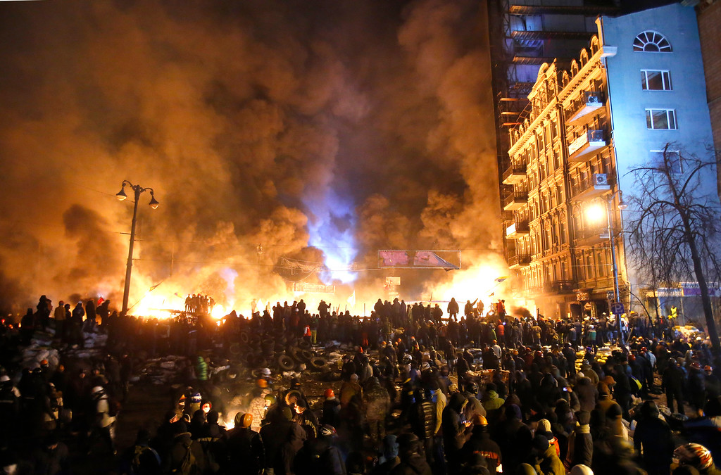. Black smoke and fireballs rise during clashes between protesters and police in central Kiev, Ukraine, early Saturday, Jan. 25, 2014. (AP Photo/Sergei Grits, File)