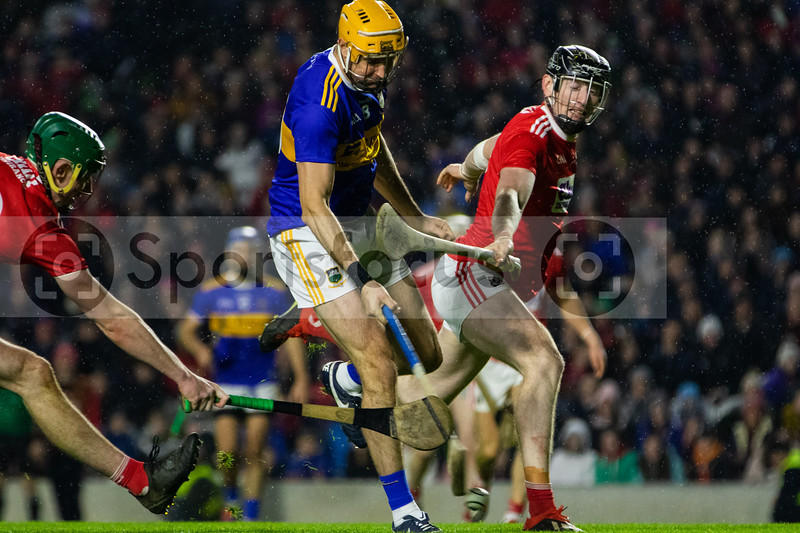 Tipperary's Seamus Callanan is challenged by Cork's Robbie O'Flynn and Damien Cahalane
