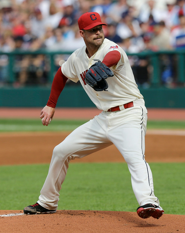 . Cleveland Indians starting pitcher Corey Kluber delivers in the first inning of a baseball game against the Detroit Tigers, Monday, Sept. 1, 2014, in Cleveland. (AP Photo/Tony Dejak)