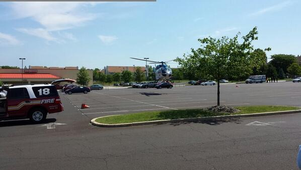 . A medical helicopter takes off with a patient from the Redner\'s grocery store parking lot in Montgomery Township with a shooting victim Monday, June 2, 2014.