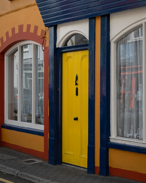 View of yellow store door and window along street, Kinsale, County Cork, Ireland