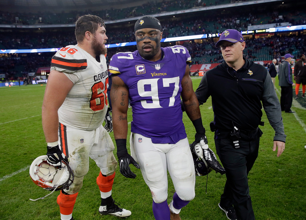 . Cleveland Browns guard Spencer Drango , left, and Minnesota Vikings defensive end Everson Griffen (97) greet after an NFL football game at Twickenham Stadium in London, Sunday Oct. 29, 2017. The Vikings won 33-16. (AP Photo/Tim Ireland)