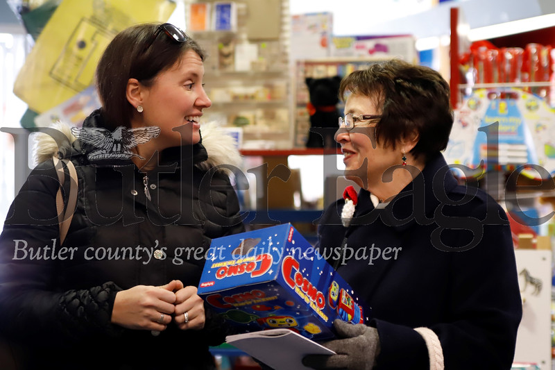Katie Buzard (left) discusses a gift idea for her son with her mom Susan Frantz(right) at Room To Grow toy store in Zelienople during the town's Small Business Saturday festivities. Frantz, a former Zelienople resident said she comes from her Franklin Park home to Zelienople to do some of her Chrismas shopping ever year. Seb Foltz/Butler Eagle