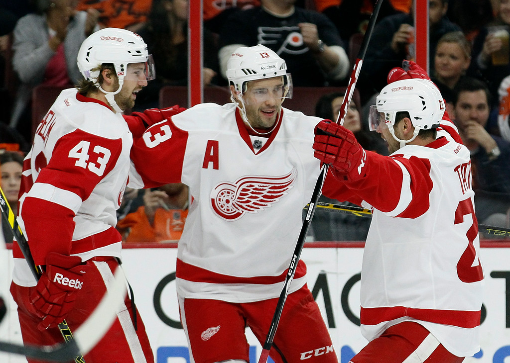 . Detroit Red Wings\' Pavel Datsyuk, (13), center, celebrates his goal with teammates Darren Helm, (43) and Tomas Tatar, right, in the third period of an NHL hockey game against the Philadelphia Flyers, Saturday, Oct. 25, 2014, in Philadelphia. The Flyers won 4-2. (AP Photo/Tom Mihalek)