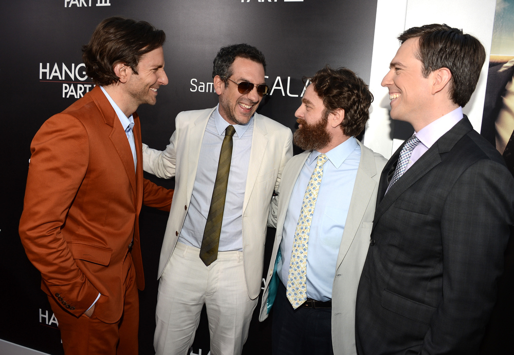 """. Actor Bradley Cooper, director Todd Phillips, actors Ed Helms, and Zach Galifianakis arrive at the premiere of Warner Bros. Pictures\' \""""Hangover Part 3\"""" on May 20, 2013 in Westwood, California.  (Photo by Kevin Winter/Getty Images)"""