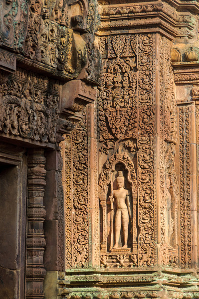 """The figure guarding the door is called a """"dvarapala."""" It is supported here by three lions."""