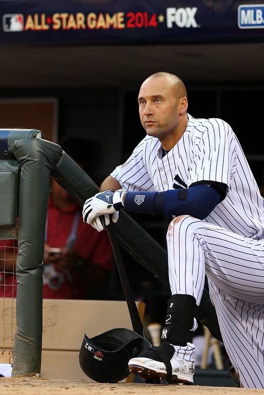 . American League All-Star Derek Jeter #2 of the New York Yankees looks on from the dugout during the 85th MLB All-Star Game at Target Field on July 15, 2014 in Minneapolis, Minnesota.  (Photo by Elsa/Getty Images)