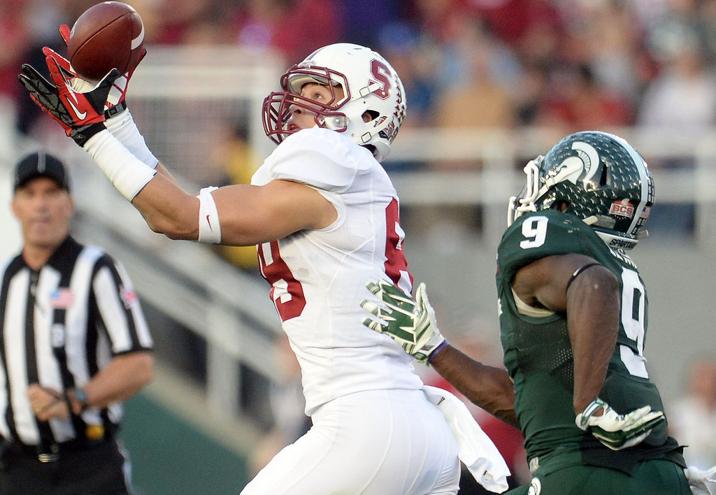 . Stanford wide receiver Devon Cajuste (89) catches a pass for 81 yard pass play over Michigan State safety Isaiah Lewis (9) in the second half of the 100th Rose bowl game in Pasadena, Calif., on Wednesday, Jan.1, 2014. Michigan State won 24-20.  (Keith Birmingham Pasadena Star-News)