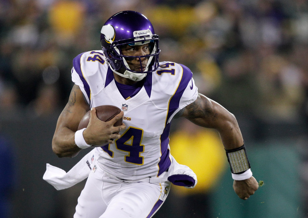 . Minnesota Vikings quarterback Joe Webb (14) runs during the first half of an NFL wild card playoff football game against the Green Bay Packers Saturday, Jan. 5, 2013, in Green Bay, Wis. (AP Photo/Kiichiro Sato)